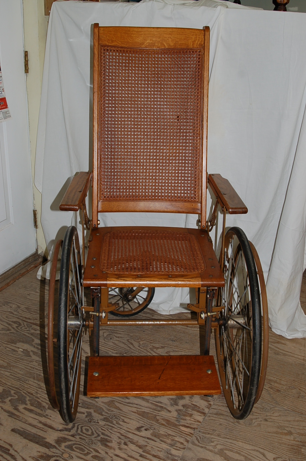- Antique Wheelchair Refinished And Repaired.